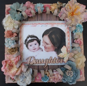 Daughter: My Minds Eye Papers, A2Z Scraplets Chipboard Frame, Glimmer Mists, Various Flowers including Manor House Creations, Prima, Kaisercraft & Green Tara, Tim Holtz Crackle Paint.