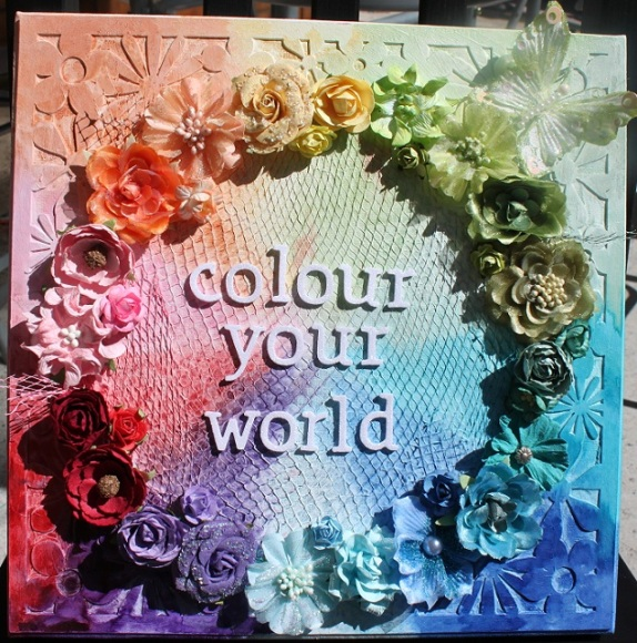 Colour your world: 12x12 Canvas, A2Z Scraplets Chipboard, Tattered Angels Glimmer Mists, Gesso, Onion Bag, Thickers, Various Flowers including Prima, Kaisercraft & Green Tara.